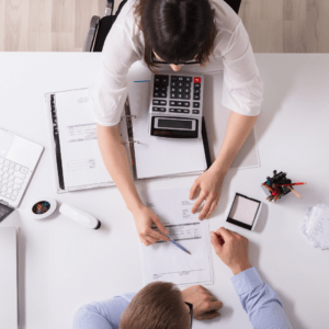 business law and litigation between two people at a desk
